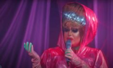 a drag queen performs in a pink outfit on the Russia drag series 'Royal Cobras'