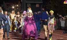 """High school students and staff members in Burlington Vermont perform on the football field during a """"drag ball"""" homecoming show"""