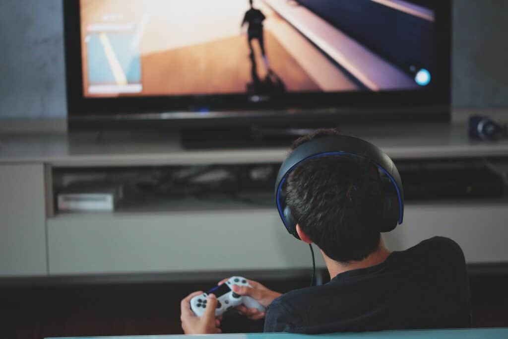 A teenager plays video games