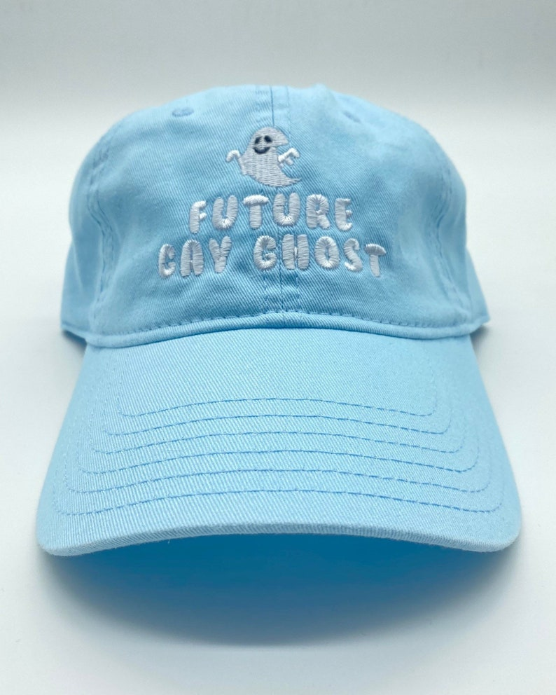 """This baby blue dad hat features the embroidery """"Future Gay Ghost""""."""